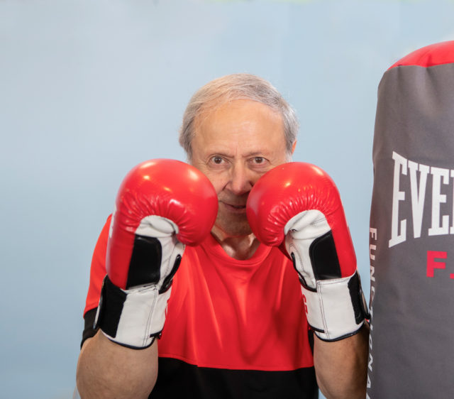 A retired independent Living Boxer exercises at the newly renovated fitness center in Birch Hill, Manchester NH