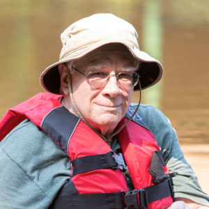 Independent Living Resident fishing at the cedar swamp at Birch Hill in Manchester, NH